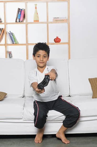Royalty Free Barefoot Boy Playing Video Game Pictures